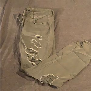Army green jeans with rips